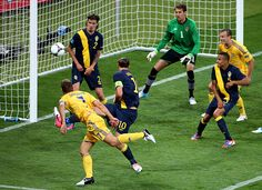 Andriy Shevchenko scores his second goal of the day in leading Ukraine past Sweden 2-1 at the European Championship on Monday. Many analysts felt Shevchenko was too old, says SI's Georgina Turner, but the veteran is now a Ukrainian hero. (Martin Rose/Getty Images)  TURNER: Shevchenko becomes a national heroMARCOTTI: Superhero Shevchenko powers Ukraine #EasyPin