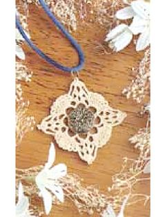 Vintage Lace Pendant  I can totally see a clutch made out of these squares, and one square with the button...add a loop to the flap to close.
