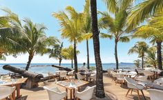 Situated on Mont Choisy Beach, this Beachcomber resort offers bright rooms with views of the tropical gardens, pools, or Indian Ocean. Mauritius Resorts, Mauritius Travel, Bright Decor, Bright Rooms, Northern Island, Glass Bottom Boat, Family Resorts, Thatched Roof, Massage Room