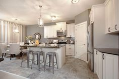 Kitchen with central island and pantry in the Orion II showhome in King's Heights in Airdrie by Shane Homes Central Island, Kitchen Nook, Decoration, New Homes, House Design, Pantry, House Ideas, Furniture, Diy