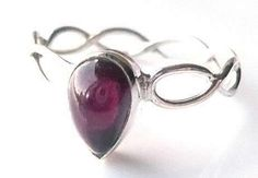 Pretty silver ring, set with a pear shape, wine red, 8x5mm garnet cabochon.  Price £12