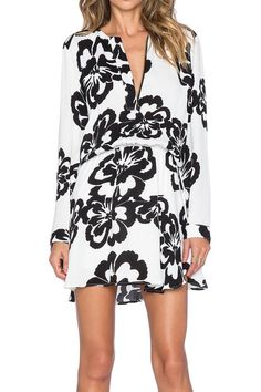 """Black and white, long sleeve, mini dress. Dry clean only.Partially lined.Front zipper closure.Elasticized waist. Button cuff sleeves.    Measures: 32"""" L   Caro Mini Dress by Karina Grimaldi. Clothing - Dresses - Printed Clothing - Dresses - Mini Clothing - Dresses - Long Sleeve Chicago, Illinois"""