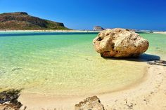 Balos beach, formed by a massive rock situated in the sea and connected to the mainland by a sandy peninsula, creating a huge beach with white sand! Balos Beach, Most Beautiful Beaches, Greek Islands, Greece Travel, Summer Time, Photo S, Crete Chania, Places, Water