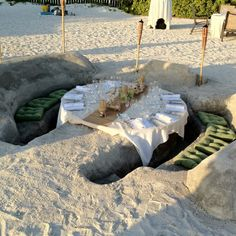 I love this -- a table and seats dug from the beach!
