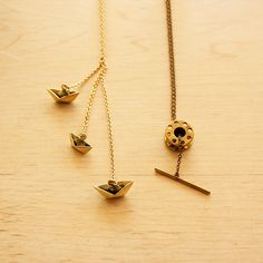 gold bobbin necklace... for the crafter in your life :)