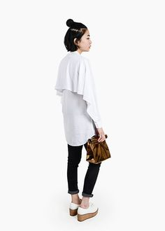 Crisp white blouse featuring a silk collar and waterfall flap at back. Shop sustainable/ethically-produced women's fashion at New Classics Studios.