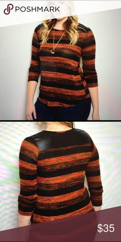 Rust black plus size top. COMING SOON This top features a rounded neck line, multi colored stripe print all over, three-quarter sleeves and relax fit. 98% polyester, 2% spandex. Made in the USA. Available in multiple sizes. 03172017875632 Tops Blouses
