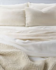 Cozy, sexy, cool: The Flanders Linen pillow, Luzon Percale sheets, and Big Sky throw mean there's zero reason to get out of bed this weekend.  Available now. Link in profile to shop [US].