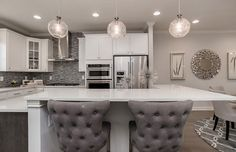 This inviting kitchen is the epitome of refined elegance in chic, soothing grays.   Pulte Homes