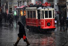 Snow falls on Istiklal Avenue in Istanbul on January 7, 2013. By rail - Photos - The Big Picture - Boston.com