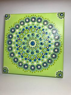"""Original Mandala Painting on Canvas, Dotilism, Dot Painting, Aboriginal Art, Henna Meditation Art, Healing/ Calming, Hand Painted with acrylic paint on Canvas , sprayed multiple times with high gloss sealer to protect paint and aging. Colors are: green, blues, yellows Canvas size: 8"""" x"""