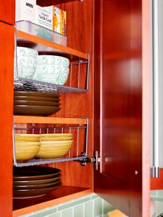 Ways to Squeeze a Little Extra Storage Out of a Small Kitchen Smart extra storage. Ways to Squeeze a Little Extra Storage Out of a Small Kitchen Small Kitchen Storage, Extra Storage, Kitchen Small, Hidden Storage, Dish Storage, Cheap Kitchen, Storage Baskets, Small Kitchen Space Savers, Ideas For Small Kitchens