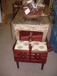 Opposite side of farm table....Vintage sewing box....