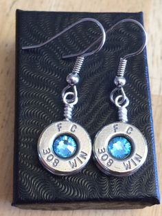 Beautiful Dangles.  Nickel 308's with aquamarine crystal.