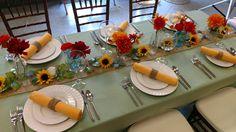 Late summer table design. #wildflowers #tabledesign #summertheme #colorfuldesign #tabletop #sunflowers #redorangeflowers #tableideas #tabledecorations #weddingideas