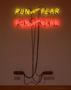 bruce nauman: mindfuck exhibition at hauser and wirth, london    first image  'run from fear, fun from rear', 1972 by bruce nauman  neon tubing with clear glass tubing suspension frame  two parts:   20.3 x 116.8 x 5.7 cm  / 8  x 46  x 2 1/4 in   18.4 x 113 x 5.7 cm  / 7 1/4 x 44 1/2 x 2 1/4 in  image © 2012 bruce nauman / artists rights society (ARS), new york / DACS london  private collection
