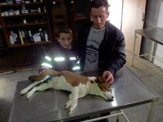 Farmer and his son: Both are happy that we help them treat and castrate their own dog, as they have no money for the veterinarian!