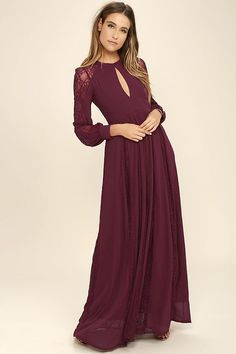 Put on your flower crown and the Field of Dreams Burgundy Lace Maxi Dress and let the magic begin! A mock neck (with double button closure) and keyhole cutout, top a seamed bodice and set-in waist, framed by long sleeves with sheer lace panels and buttoned cuffs. Full maxi skirt features flaring sheer lace godets.  Hidden Back zipper.