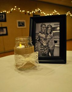 Use framed black and white photos of sisters as table centerpieces during Preference