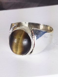 Men's tiger's eye and Sterling silver signet ring. A personal favorite from my Etsy shop https://www.etsy.com/listing/471246602/vintage-sterling-silver-tigers-eye-ring