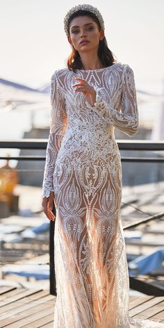 Fitted lace unique wedding dress with long sleeves | Ida Torez Wedding Dresses 2021 Brave Glanze Collection - 01231- Feeling of passion | How to Choose a Wedding Dress in 2021- Belle The Magazine | See more gorgeous bridal gowns by clicking on the photo