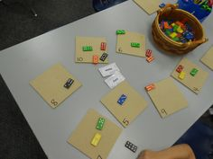 Use numbered boards to sort quantities on dominoes!