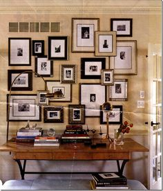This is such a great way to hang all the different sized frames with family pictures that i have. Will definitely do this after i pant my walls in the living room!