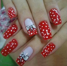 Red with white polka dots and bow detail.