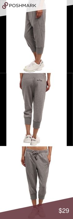 "Adidas by Stella McCartney Essential 3/4 Pant Women's Adidas by Stella McCartney Essential 3/4 Pant. Size medium; 15"" width, 11"" rise, 19.5"" inseam. Main body: 67% cotton, 33% polyester. Ribbing: 98% cotton, 2% spandex. Sweatpants in medium grey color. ""Your relaxed style will thank you when you pick up the essential 3/4 pant."" Tapered legs, Drawstring waistband and cuffed hems. Hand pockets, brand name and logo on back right. In good used condition! Comfortably worn and sweats have some…"