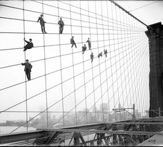 vintage everyday: Brooklyn Bridge, showing painters on suspenders, October 7, 1914