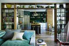 Eclectic kitchen of this London home is entered through a framed doorway filled with books, bowls and glassware -- designed by Hubert Zandberg Interiors. Eclectic Kitchen, Eclectic Living Room, Kitchen Modern, Green Kitchen, Küchen Design, House Design, Interior Design, Living Tv, Living Room Divider