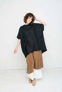 linen black top and brown banded trousers or skirt
