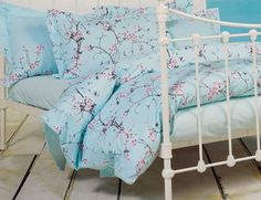 Cherry blossom bedding - blue background I like the blue background, but I think there are a few too many blossoms