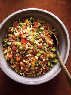In addition to the mixture of vegetables, fresh mint and bright lemon, we added plump Israeli couscous and pine nuts to this salad recipe, boosting it into satisfying main-course territory. Raw Food Recipes, Healthy Dinner Recipes, Salad Recipes, Vegetarian Recipes, Rice Recipes, Meat Recipes, Healthy Snacks, Israeli Couscous Salad, Couscous Salat