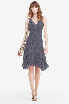 In the season's essential prints, the DVF Dita is a timeless slip dress style. Bias cut with a draped neckline and asymmetrical hem, the DVF Dita can be worn alone, or layered with ease. Slip on style. Falls to below the knee. Fits true to size.