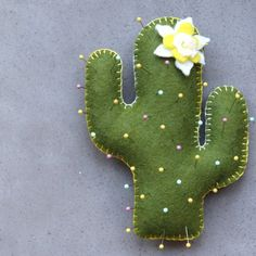 Learn how to make a cactus pin cushion with free pattern at Pretty Prudent.