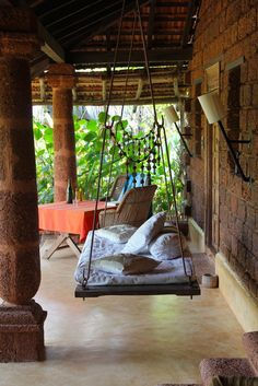 A Jhoola (Indian Swing) at a retreat in India. This is sweet. Oh to have a large covered porch.