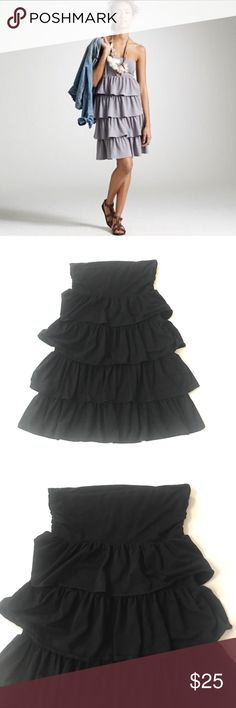 """J. Crew Black Strapless Ruffle Dress Perfect for running about town or a day at the beach; so comfy! Strapless w/ layers of ruffles. Fabric has a lot of stretch. Size Medium. Approx measures lying flat: bust 14.5"""", length 29"""". Excellent used condition. Color is black.  •Lowball offers declined •no trades •ask all questions before buying •unfair ratings from buyers are reported & buyer blocked - I don't misrepresent my products; what you see is what you get & my prices are fair. Please be…"""