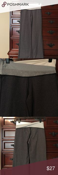 Lululemon yoga pants with accent waist Lululemon grey heather yoga pants. Unique waistband with white and grey accent. Looks great on waist. Flair bottom leg. In great condition. No pilling. Worn Once. Washed in cold and air dried. lululemon athletica Pants Leggings