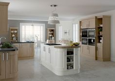 English kitchen units, mix of white and natural with island. Visit Alex Lee Kitchens, on Hillmorton Road in Rugby.