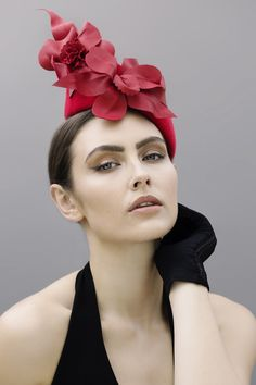 Wren is a dramatic cocktail hat with a leather flower flourish! Made from velour felt the structured base is finished with soft organic flowers.  The stylised flowers are made from soft matching leather. This is an excellent design for adding drama and height to your outfit. Item Details