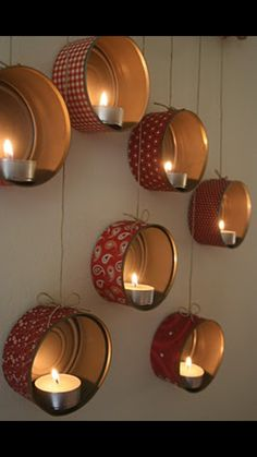 Decorated/covered cookie tins as candle holders...DIY..cute for wall decor.