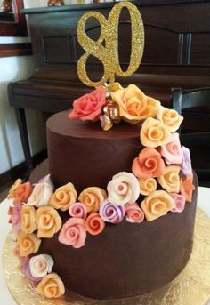 Beautiful 80th birthday cake... rich and moist chocolate cake with milk chocolate ganache filling and dark ganache covering, finished with handmade fondant/gumpaste roses! Stunning! By www.sophisticake.co.za