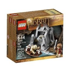 "LEGO The Hobbit Riddles for The Ring by LEGO LOTR. $4.99. Rock measures over 2"" (6cm) high, 2"" (7cm) wide and 2"" (6cm) deep. Features rock with opening front section and secret compartment for the Ring. Includes 2 minifigures: Gollum and Bilbo Baggins in journey outfit with Sting. Use the reveal function to open the rock and get the Ring!. Boat measures over 0.5"" (1.5cm) high, 2"" (6cm) long and 1"" (3cm) wide. From the Manufacturer                On the shores of an ..."