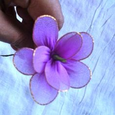 How to make flowers from old tights via @Guidecentral - Visit www.guidecentr.al for more #DIY #tutorials