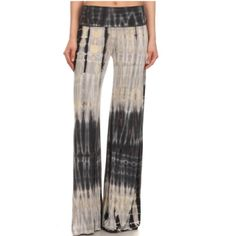 """Navy/Grey Tie Dye Palazzo Pants These amazing navy and grey palazzo pants give on an earthy vibe. Flattering fold over waistband, and flared bottoms make these a really gorgeous pant. Super comfortable 95% rayon, 5% spandex. The 2nd pic, is just to show the fit, not the color. Laying flat, the s,all measures 12"""" across the waist. The medium measures 13"""". The large measures 15"""". Small inseam is 31"""", medium inseam is 32"""". Large inseam is 33"""". Fold over waistband is 5"""". Tammysbeachwear Pants…"""