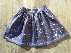 little girl's skirt in Map of Our Sky border fabric by MariaO