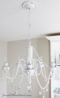 DIY Chandelier. I have to spray paint my black one and add a splash of color in the crystals as well!