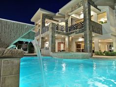 Love the tile around the columns and water feature in the pool.