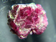 what does ruby red look like | This ruby crystal shows a rough hexagonal outline with a squat crystal ... *****   Pink-red . . . .
